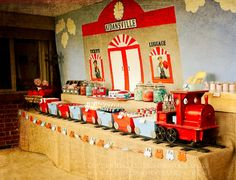 Train Party: Love this table setting, especially the train carrying the food across the front