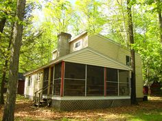 SOLD! Sunny Point Cottage Features boatslip, SEASONAL LAKE VIEW and PRIME LOCATION easy walk to swimming access in Lake Wallenpaupack. Yester-year charm of T Latch hook doors, hardwood floors, Cathedral ceiling with Fireplace, 5 Bedrooms, OVERSIZED screened porch entertaining. COOL LAKE BREEZES, GREAT FISHING and water play, what are you waiting for? TIME TO VACATION!