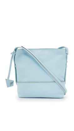 Exposed zip trim lends an industrial touch to this slouchy Botkier cross-body bag. The inset top zip opens to an unlined, metallic interior with 2 pockets. Cher Horowitz, Baby Blue, Cross Body, Dust Bag, Shoulder Strap, Latest Trends, Blues, Swag, Metallic