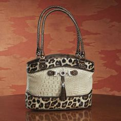Lola Leopard Bag by Marc Chantal from Midnight Velvet. An elegant pedigree comes with this stylish and roomy bag, with mix of embossed reptile patterns and the leopard trim.