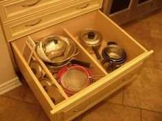 2nd floor - Kitchen - Range wall - Under the range drawers (H2) - Alternate lower drawer storage for pots and lids w/ dividers