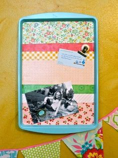 Turn a dollar store cookie sheet into a pretty, decorative memo board using scrap paper and Mod Podge. This #dollarstore craft is thrifty and easy to make, and it makes a big impact on your craft room decor.