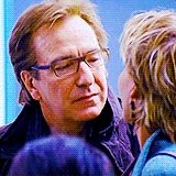 """Alan Rickman as Harry with Emma Thompson as his wife Karen in """"Love Actually"""" 2003 via GIPHY"""