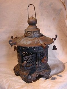 Vintage Cast Iron Japanese Hanging Lantern  ,I have this exact one, would love some insight on the age etc,,