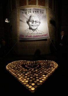 A South Korean man stands near the banner of former South African President during a meeting to celebrate for Nelson Mandela's birthday in Seoul, South Korea Nelson Mandela, Korean Men, Banner, African, Celebrities, Birthday Celebrations, South Korea, Seoul, Happy