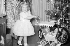 1950s...Way back when Christmas was considered a holiday and dressing up was a requirement !