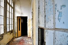 Abandoned: Walls of the abandoned hospital are now peeling after it was shut down in 1978 because its practices were deemed cruel (Ospedale Psichiatrico di Volterra).