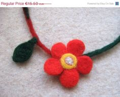 Get yourself a simple, but stylish statement necklace with an accent red flower! Its playful charm will make your day livelier :) #handmade #jewelry #flower
