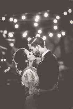 Bride and groom photo under festoon lights | Angela Rose Photography