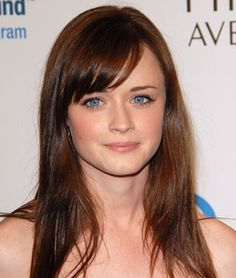 Swoopy bangs and a sultry side-part create a seriously sexy hairstyle for Alexis Bledel.