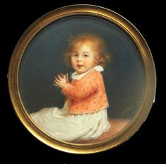 Seated with hands raised in a clapping motion wearing white dress and orange cardigan embellished with flowers  <br />Set in a gilt-metal mount <br /> <br />It has not been possible  to identify th...