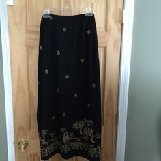 """Alfred Drunner woman's skirt -22W Alfred Drunner woman's 22 black skirt with light brown animal print. Skirt is somewhat sheer. Back and sides of waist are an easy 1"""" elastic for comfort. Skirt has a 16 1/2"""" side slit for a sexy look. 37"""" long. 100% cotton for easy wash and wear. Alfred Dunner Skirts"""