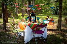 fiesta! Lanterns and colorful fabric on tables