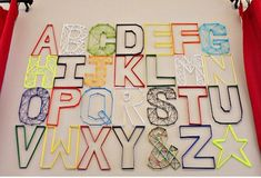 Fabulous DIY Alphabet Wall Art. Perfect for a kids room!! Check it out on Design Dazzle.