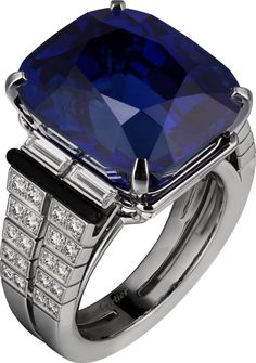 CARTIER. Ring - white gold, one 27.16-carat cushion-shaped sapphire from Ceylon, calibré-cut diamonds, onyx, brilliant-cut diamonds. #Cartier #CartierMagicien #2016 #HauteJoaillerie #FineJewelry #Sapphire #Diamond