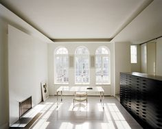 Shahid's reading room includes a custom table, a pair of Paul Kjaerholm chairs and a Richard Prince drawing.