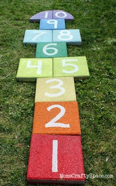 This hopscotch board—made out of pavers—works double-time as a game for kids (or adults!) and a fun way to add a pop of bright color to your lawn. Get the tutorial at Happiness is Homemade. - CountryLiving.com #outdoorideasbackyard