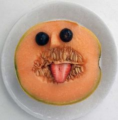 Funny food art : Simple yet effective, give your rockmelon a bit of cheek.