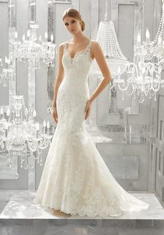 """Romantic Frosted Alençon Lace Appliqués Create A Soft and Feminine Fit and Flare Wedding Gown. Scalloped Hemline Lace Complete and Open Keyhole Back Complete the Look. Shown with Detachable Tulle Train (not included), Sold Separately as Style 11270. Available in Three Lengths: 55"""", 58"""", 61"""". Colors Available: White, Ivory, Ivory/Light Gold."""