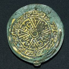 Anglo-Saxon disc brooch c 450-550 AD    From a female burial at Linton Heath in Cambridgeshire