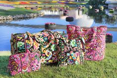Disney-Inspired Handbags and Accessories by Vera Bradley to Bloom This Fall at Disney Parks: OMG, that  black pattern will be mine! What an adorable idea for a vacation duffle! #DisneySMMoms