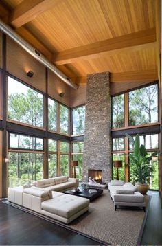 .wow nice view. stone fireplace white couch