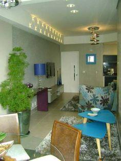 Sala de estar de um apartamento de 67 m². Projetado por Liane Martins.
