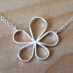 FLOWER OUTLINE - Sterling Silver Charm with a Sterling Silver Chain $18.00