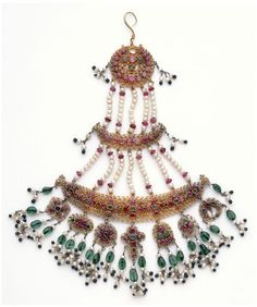 Delhi, India  c.1853 (made). Materials and Techniques: Gold filigree with claw settings and pink sapphires, aquamarine with colouring material behind green glass and pearls.