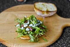 Fried egg with blue cheese, bacon, and frisée