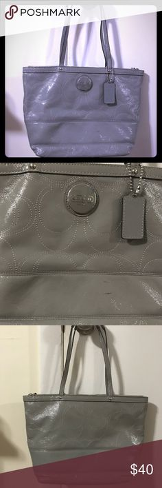Grey Coach tote Grey Coach tote. EUC with a blue interior. It has a small mark on the front that I have not tried to remove. It has great storage on the inside and the exterior material makes it great in all weather (though I'm not sure it's waterproof)  Bundle 2 or more items from my closet and get 15% off ! Coach Bags Totes