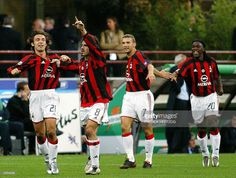 Milan AC's (fromL) Andrea Pirlo, Gennaro Gattuso, Andry Shevchenko and Clarence Seedorf celebrate after teammate Filippo Inzaghi scored the first goal against Inter Milan during their Italian Serie A match 05 October 2003 at San Siro stadium in Milan.