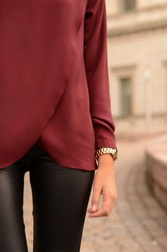 burgundy long sleeve blouse with leather leggings