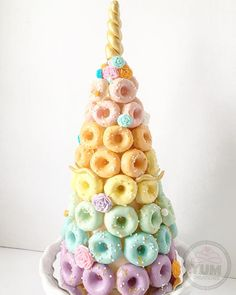 unicorn donut cake tower donut unicorn cake + donut unicorn cake birthday + unicorn and donut cake + unicorn donut cake tower + donut and unicorn birthday cake + diy unicorn donut cake + donut grow up unicorn cake + unicorn donut smash cake Donut Party, Donut Birthday Parties, Donut Birthday Cakes, Party Party, Mini Cakes, Cupcake Cakes, Fest Des Fastenbrechens, Donut Tower, Cake Tower
