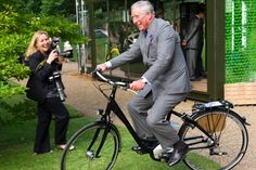 HRH Prince Charles tries out electric-assist bicycle.