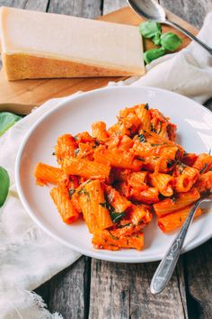 This orange pasta sauce with rigatoni is a delicious change-up from the typical pasta dishes you're used to seeing at the dinner table and so easy to make.