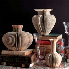 Beautiful paper vases made from repurposed books. The Repurposed Library by Lisa Occhipinti contains 33 projects to make art from old books.