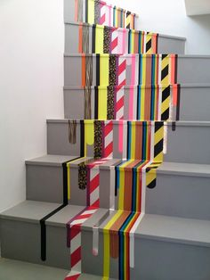 Easy washi tape stair runner looks painted but has 0-minute dry time. Genius