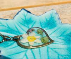 Dried narcissus pendant by twocatsboutique on Etsy, $30.00