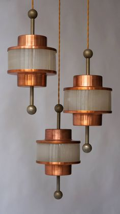 Hollywood Regency Brass Triple Pendant Chandelier | From a unique collection of antique and modern chandeliers and pendants at https://www.1stdibs.com/furniture/lighting/chandeliers-pendant-lights/