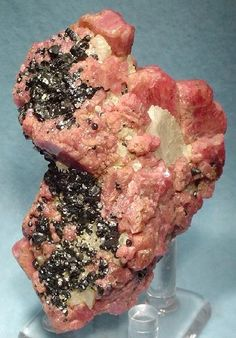 Franklinite on top of Rhodonite. Franklinite comes from Franklin, New Jersey, not too far from where we live. Pat & I went hunting for some not long after we moved to NJ from Illinois. What we found was not this cool because the quarry had been around for many years prior to our arrival.