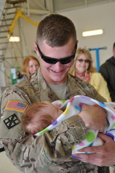 Specialist Dillon Baer meets his infant daughter Grace.   48 Soldiers Meeting Their Children For The First Time