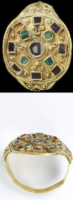 Gold ring, the circular bezel decorated with filigree and set with pastes, Lombardy, 6th to 7th century.