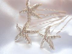 Hey, I found this really awesome Etsy listing at http://www.etsy.com/listing/117052141/crystal-starfish-hair-pin-bridal-hair