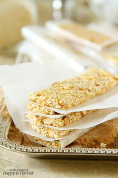 Pasteli, the sweet and moreish sesame seed and honey bars dotted with roasted nuts is so easy to make at home. Enjoy these bars of goodness whenever you fancy a snack or a boost of energy. They make excellent Holiday gifts too! Greek Desserts, Greek Recipes, Frozen Yogurt Dots, Candy Recipes, Dessert Recipes, Sesame Seeds Recipes, Cypriot Food, International Recipes, Delicious Desserts