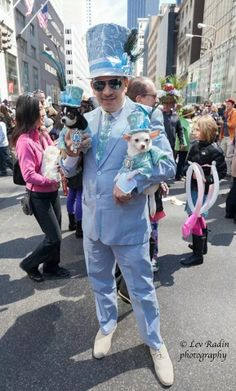 Anthony Rubio Pet Couturier designed this Lime Green and Powder Blue beaded tuxedos with top hats for his celebripups/ Couture Dogs/ Chihuahuas Bogie and Kimba and created his own tie and top hat  to wear to the 2014 New York Easter Bonnet Parade. Photo Courtesy:  Lev Radin www.AnthonyRubioDesigns.com