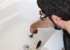Clogged bathtub drains stink -- sometimes literally. This is a fix we can all do. Recently I had to unclog my tenant's tub and decided to put together a vide… Bathtub Drain, Repair Cracked Concrete, Clean Out, Removing Popcorn Ceiling, Drain Repair, Curtains With Rings, Glass Shower Doors, Day Plan, Cleaning