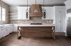 Love the warm tones in this kitchen, wood, white, and brick beige and brown tones.