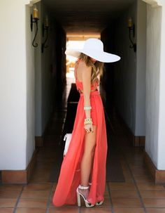 f28c98645f4ad long coral maxi dress and bright white sun hat. Perfect spring or summer  outift