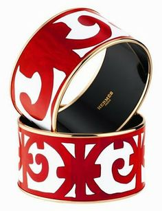 Hermès Balcons du Guadalquivir enamal cuff in red and gold. Love the treatment, placement, and size of the logo/graphics.